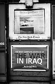 Peoria, Illinois.USA.April 2003..American Newspaper boxes advertise the war in Iraq.