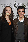 Figure Skater Sarah Hughes poses with singer Kevin Jonas at the 2012 Skating with the Stars - a benefit gala for Figure Skating in Harlem celebrating 15 years on April 2, 2012 at Central Park's Wollman Rink, New York City, New York.  (Photo by Sue Coflin/Max Photos)