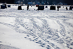 Tracks in the snow of ice fisherman and their sleds  on Lake Monona Bay in Madison, Wisconsin.