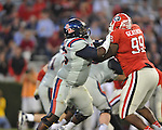 Ole Miss offensive lineman A.J. Hawkins (76) vs. Georgia's Kwame Geathers (99) at Sanford Stadium in Athens, Ga. on Saturday, November 3, 2012.