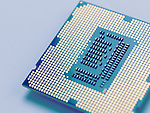 Closeup of Intel i7 3770K processor with LGA 1155 CPU socket isolated on blue background