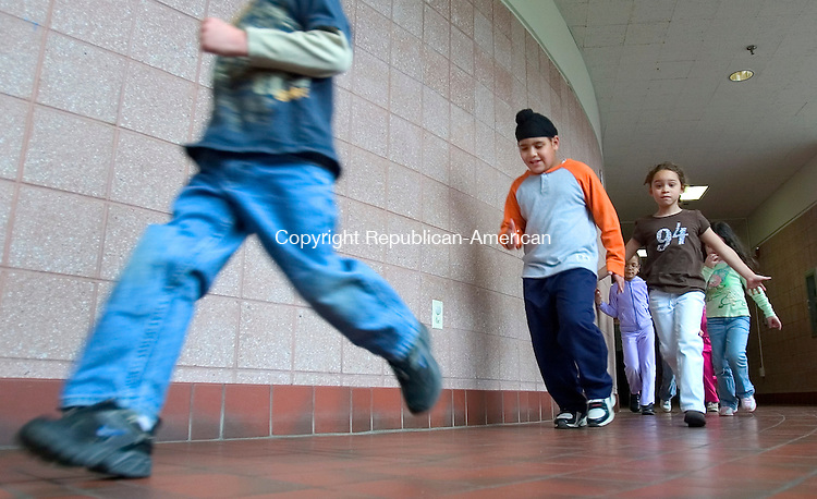 TORRINGTON, CT. 03 May 2007-050307SV01--From left, Adam Lupinos, 5, and Ashiespal Bharara, 5, walk the halls to music during a program called All Students Exercise Simultaneously at Forbes School in Torrington Wednesday.<br /> Steven Valenti Republican-American