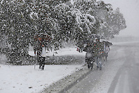 Israelis walk during snow storm in Jerusalem. December 12, 2013.  Photo by Oren Nahshon