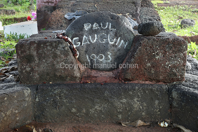 Stone with date of death, on the tomb of the French artist Paul Gauguin, 1848-1903, in Calvary Cemetery, near Atuona, on the island of Hiva Oa, in the Marquesas Islands, French Polynesia. Gauguin lived in Atuona from 1901, having previously lived on Tahiti for many years. His tomb features Oviri, a sculpture from 1894 by Gauguin, a cast of which was placed on his grave in 1973. Picture by Manuel Cohen