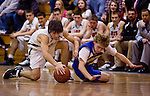 PLYMOUTH, CT--03 January 08--010308TJ07 - Terryville's Ronny Bilodeau (4), left, and Housatonic's Chris Lynch (4) scramble for a loose ball during Terryville High School's 68-30 victory over Housatonic Valley Regional High School on Thursday, January 3, 2008. T.J. Kirkpatrick/Republican-American