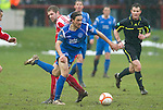 Brechin v St Johnstone....12.03.11  Scottish Cup Quarter Final.Danny Invincibile is tripped by Neil Janczyk.Picture by Graeme Hart..Copyright Perthshire Picture Agency.Tel: 01738 623350  Mobile: 07990 594431