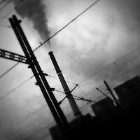 A smoking chimney of the Prunéřov I coal-fired power plant seen from the train passing through the industrial area in the north of the Czech Republic, 4 September 2013. The whole nothern region of the country constantly suffers environmental impacts from the coal mining and the coal-fired energy production.