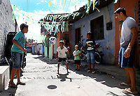 Children play football bare foot down a decorated street in Fortaleza, Brazil, one of the 12 host cities of the 2014 FIFA World Cup