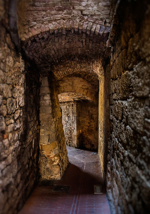 SAN GIMIGNANO, ITALY - CIRCA MAY 2015:  Passage in the walled city of San Gimignano in Tuscany