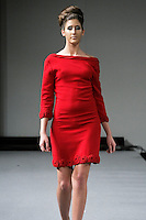 Model walks the runway in an outfit from the Laura Williams Fall 2012 Dreams collection, by Laura Williams, during Couture Fashion Week New York, February 17, 2012.