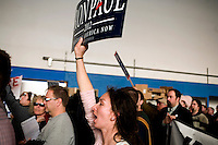Ron Paul supporters hold signs at a rally at Jet Aviation in Nashua, New Hampshire, on Jan. 6, 2012.  Paul is seeking the 2012 GOP Republican presidential nomination.