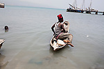A man heads out on his boat on July 8, 2010 in in the Cite Soleil neighborhood of Port-au-Prince, Haiti.