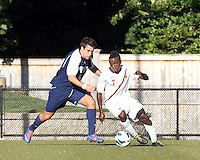 Boston College midfielder Derrick Boateng (7) drives for the net as University of Rhode Island (URI) defender Mikey Welsh (4) closes. Boston College defeated University of Rhode Island, 4-2, at Newton Campus Field, September 25, 2012.