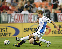 Stephen King #20 of D.C. United slips a shot past Christopher Leitch #3 of the San Jose Earthquakes during an MLS match at RFK Stadium in Washington D.C. on October 9 2010. San Jose won 2-0.