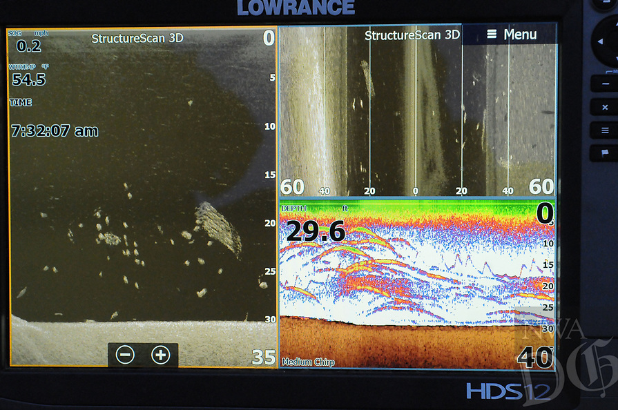 NWA Democrat-Gazette/FLIP PUTTHOFF <br /> Fish show up as arcs on most depth finder screens, as seen at lower right Feb. 24 2017 on Wiegmann's unit. Three underwater views are displayed here.