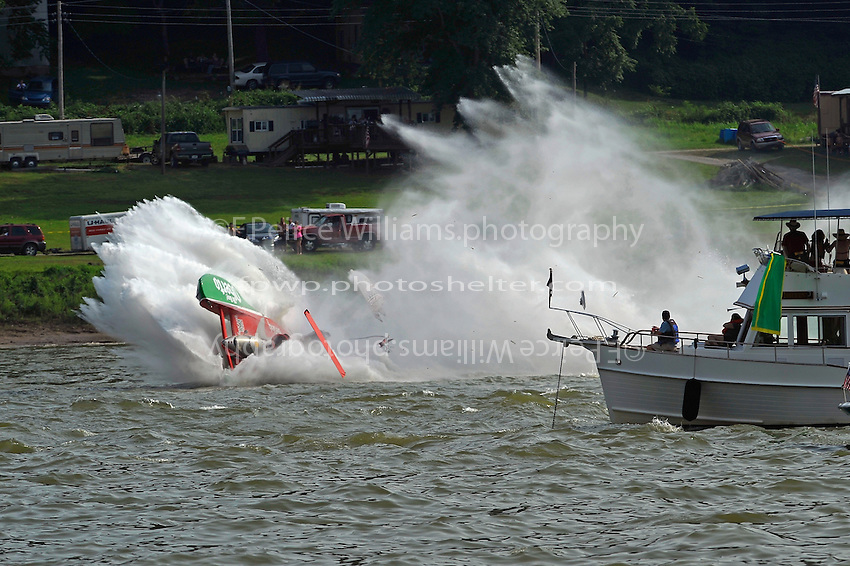 """Frame 9: On the 4th lap of the final heat David Villwock, U-96 """"Spirit of Qatar"""" spins into the path of Steve David, U-1 """"Oh Boy! Oberto"""", David t-bones Villwock and then launchs off the the Qatar hull into the air rolling over once and coming to stop upright. Both drivers were unhurt."""
