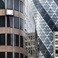 Detail of the Swiss Re building, known as the Gherkin, 1997 -  2004, Foster and Partners, Arup Engineering, London, UK amid the other high tech architecture buildings. Picture by Manuel Cohen