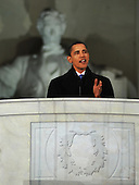 Washington, DC - January 18, 2009 -- United States President-elect Barack Obama speaks to the crowd gathered at the Lincoln Memorial on the National Mall in Washington, D.C., Sunday, January 18, 2009, during the inaugural opening ceremonies.  More than 5,000 men and women in uniform are providing military ceremonial support to the presidential inauguration, a tradition dating back to George Washington's 1789 inauguration.  .Credit: Larry Simmons - DoD via CNP.
