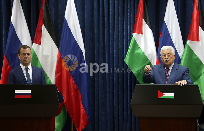 Palestinian President Mahmoud Abbas and Russian Prime Minister Dmitry Medvedev attend a joint news conference in the West Bank city of Jericho November 11, 2016. Photo by Shadi Hatem