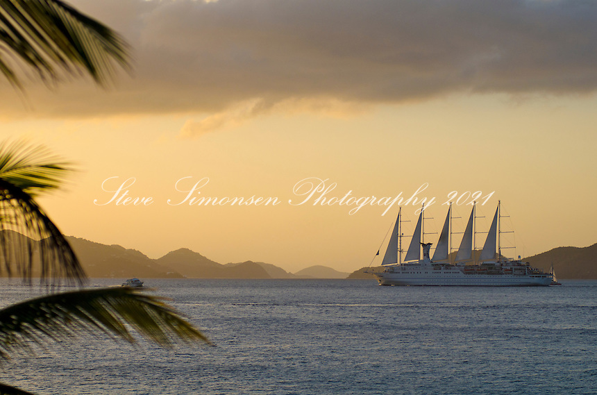 Club Med ll sails from St. John in the Pilsbury Sound at sunset<br />