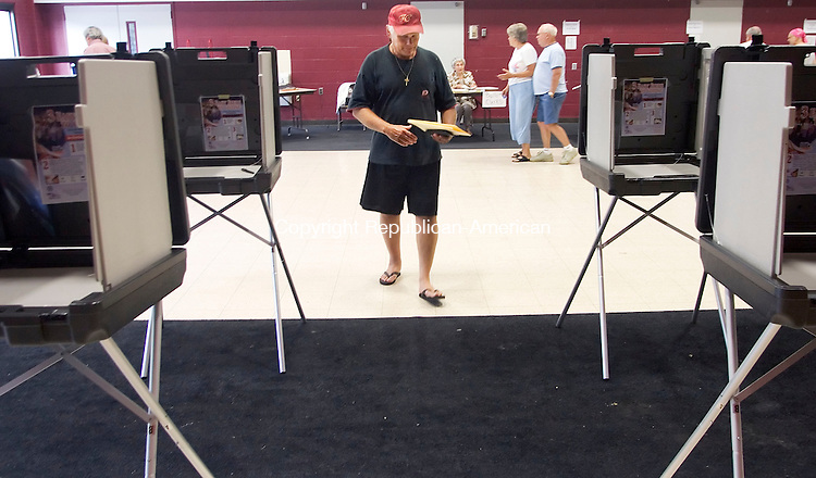 WINSTED, CT- 19 JULY 2008- 071908JT03-<br /> Winsted resident Joe Stanevich approaches a voting booth at Pearson Middle School on Saturday to vote on the town's proposed budget. This was the second time for voters to vote on the budget. &quot;It's too top-heavy, too much for education, not enough for municipal,&quot; said Stanevich, who also goes by &quot;Jumpin' Joe,&quot; about the proposed budget.<br /> Josalee Thrift / Republican-American