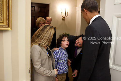 United States President Barack Obama greets Jasper Mann and his parents, Billy and Gena Mann, before signing H.R. 2005 - Combating Autism Reauthorization Act of 2011, in the Oval Office, September 30, 2011..Mandatory Credit: Pete Souza - White House via CNP
