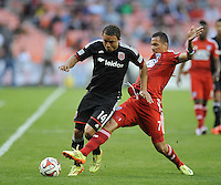 Washington D.C. - April 26, 2014: Nick DeLeon (14) of D.C. United goes against Blas Perez (7) of FC Dallas.  D.C. United defeated the FC Dallas 4-1 during a Major League Soccer match for the 2014 season at RFK Stadium.