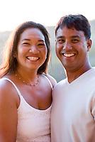 Local part Hawaiian couple at sunset