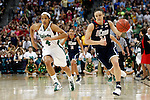 01 APRIL 2012:  Kelly Faris (34) of the University of Connecticut pushes the ball down court past Skylar Diggins (4) of the University of Notre Dame during the Division I Women's Final Four Semifinals at the Pepsi Center in Denver, CO.  Notre Dame defeated UCONN 83-75 to advance to the national championship game.  Jamie Schwaberow/NCAA Photos