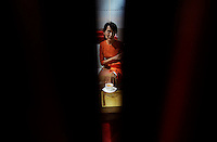 Myanmar's pro-democracy leader Aung San Suu Kyi has a cup of tea at the VIP lounge after passing the immigration control at Yangon's airport May 29, 2012. REUTERS/Damir Sagolj (MYANMAR)