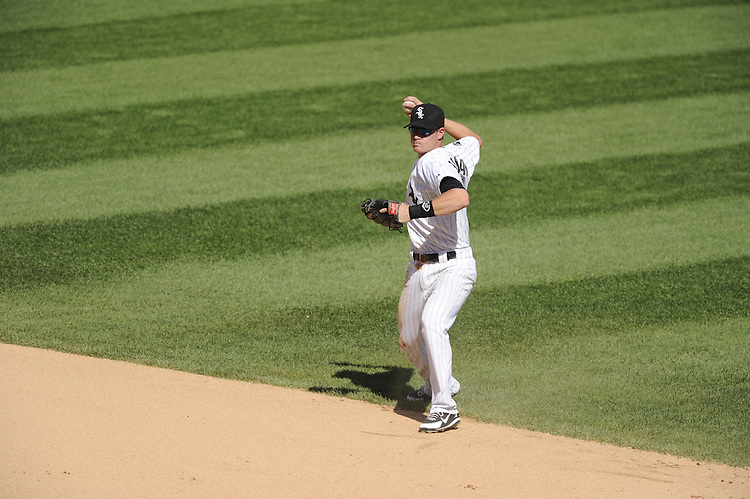 CHICAGO - MAY 15:  Gordon Beckham #15 of the Chicago White Sox throws the baseball toward first base against the Detroit Tigers on May 15, 2012 at U.S. Cellular Field in Chicago, Illinois.  The Tigers defeated the White Sox 10-8.  (Photo by Ron Vesely)   Subject:   Gordon Beckham