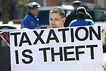 WATERBURY CT. 18 April 2017-041817SV02-Michael Picard of South Windsor protests paying taxes in front of the post office on Grand Street in Waterbury Tuesday.<br /> Steven Valenti Republican-American