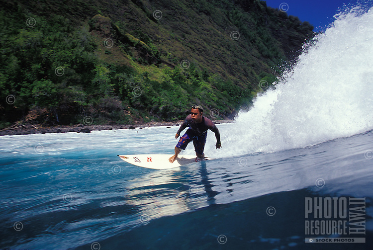 Local surfing, bottom turn on a large wave, Marquesas Islands, French Polynesia