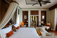 A bedroom at this luxury resort reveals the contemporary and stylish manner in which the rooms are decorated