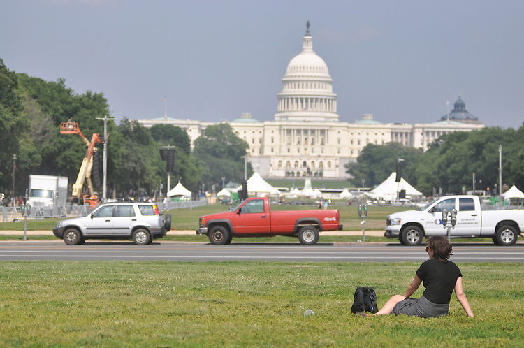 """Liz Alspector, an intern, holds a spot on the grass of the National Mall for the softball team """"The Branch"""". Wednesday June 3, 2009"""