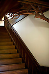 """Photo shows  the delicately carved woodwork at the head of the staircase leading to the 2nd floor of the main building of the Honma Museum of Art in Sakata, Yamagata Prefecture, Japan, on July 06, 2012. While construction of the first floor was started around 200 years ago, the second floor was added 100 years later in preparation for a visit of the then emperor. While sickness prevented the emperor's visit, his son, who was to later become emperor Showa, stayed at what is known as the Seienkaku -- or """" Pure and Distant Palace. The woodwork seen here was hand carved from a single 10-cm-thick piece of wood.  Photographer: Robert Gilhooly"""