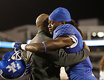 Coach Joker Phillips hugged and congratulated each of the seniors during the ceremony before the UK Football game v. Samford at Commonwealth Stadium in Lexington, Ky., on Saturday, November 17, 2012. Photo by Genevieve Adams | Staff