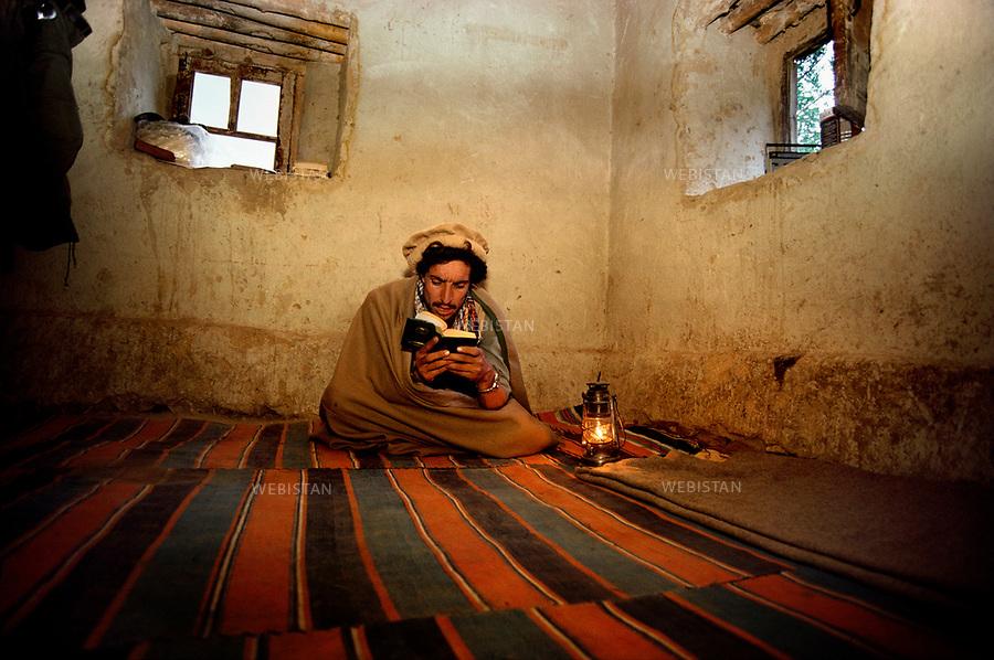 Afghanistan. Panjshir Valley. 1985. Portrait of Commander Massoud (1953-2001) reading a book in his room during the Soviet invasion of Afghanistan (1979-1989). <br /> <br /> Afghanistan. Vall&eacute;e du Panjshir. 1985. Portrait du commandant Massoud (1953-2001) lisant un livre dans sa chambre, lors de l'invasion sovi&eacute;tique d'Afghanistan (1979-1989).