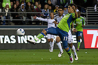 Fredy Montero(17) of the Seattle Sounders uses some fancy footwork against Los Angeles Galaxy defender A.J. DeLaGarza (20)  in the first game of the 2010 MLS Playoffs at the XBox 360 Pitch at Quest Field in Seattle, WA on October 31, 2010. The Galaxy defeated the Sounders 1-0.