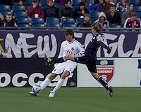 DC United defender Dejan Jakovic (5) clears the ball as New England Revolution forward Zack Schilawski (15) defends. In a Major League Soccer (MLS) match, the New England Revolution defeated DC United, 2-1, at Gillette Stadium on March 26, 2011.