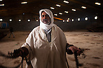 A man weeps in the tank garage of the army barracks in Banghazi on Feb. 25, 2011.