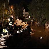 DOBRZYKOW, POLAND, MAY 24, 2010:.Rescue team in the night, observing rising waters..The latest chapter of disastrous floods in Poland has been opened yesterday, May 23, 2010, after Vistula river broke its banks and flooded over 25 villages causing evacualtion of most inhabitants..Photo by Piotr Malecki / Napo Images..DOBRZYKOW, POLSKA, 24/05/2010:.Strazacy obserwuja podnoszaca sie wode wczesnym rankiem . Najnowszy akt straszliwych tegorocznych powodzi zostal rozpoczety wczoraj gdy Wisla przerwala waly na wysokosci wsi Swiniary kolo Plocka..Fot: Piotr Malecki / Napo Images ..