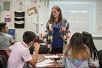 NWA Democrat-Gazette/ANTHONY REYES @NWATONYR<br /> Rachel Carethers teaches in an Algebra II class Thursday, April 13, 2017 at Springdale High School. Carethers is a special teacher on assignment and helping to implement a new style for teaching math that includes group work and cooperation.