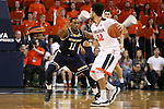 02 January 2016: Notre Dame's Demetrius Jackson (11) guards Virginia's London Perrantes (32). The University of Virginia Cavaliers hosted the University of Notre Dame Fighting Irish at the John Paul Jones Arena in Charlottesville, Virginia in a 2015-16 NCAA Division I Men's Basketball game. Virginia won the game 77-66.