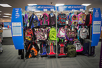 A selection of backpacks are seen in the back to school section of a Staples store in New York on Tuesday, August 20, 2013.  The back-to-school shopping season is the second busiest time for retailers. (© Richard B. Levine)