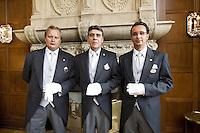 Switzerland. Canton Graubünden. St. Moritz. Hotel Carlton. Butlers. Stefan Kleinat (L), Gilles Ungright (C) head butler, Matheus Alcover (R).  © 2008 Didier Ruef