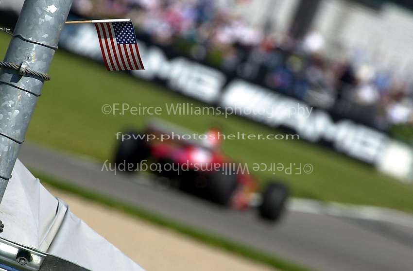 The American flag flies everywhere around the track weeks after 9.11.