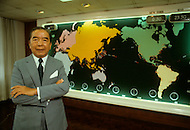 Hong Kong, China - September 25, 1981. Picture of Y.K. Pao taken infront of a map with the global locations of his fleet. Y.K. Pao (November 10, 1918 - September 23, 1991) was founder of the World-Wide Shipping Group that by the mid 1970's had become the largest shipping company in the world.