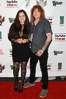 LOS ANGELES, CA, USA - OCTOBER 26: Carolina Ferreira, Steven Adler arrive at An Evening Of Art With Billy Morrison And Joey Feldman Benefiting The Rock Against MS Foundation held at Village Studios on October 26, 2014 in Los Angeles, California. (Photo by David Acosta/Celebrity Monitor)