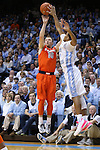 26 January 2015: Syracuse's Trevor Cooney (10) shoots over North Carolina's Nate Britt (0). The University of North Carolina Tar Heels played the Syracuse University Orange in an NCAA Division I Men's basketball game at the Dean E. Smith Center in Chapel Hill, North Carolina. UNC won the game 93-83.